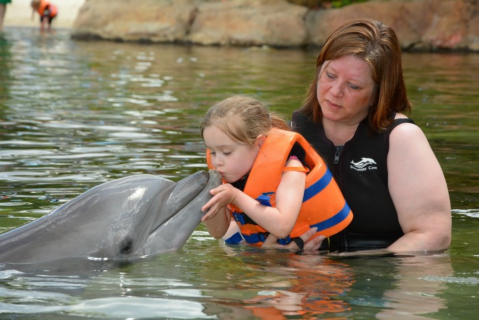 Emma kissing the Dolphin with me