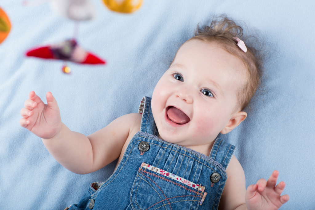 happy-baby-playing-with-mobile